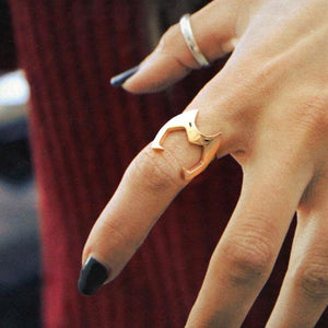 catra helmet ring fitted on the index finger of a girl with her fingers spread open