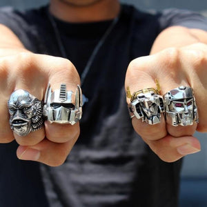 shot of a man wearing the creature, voltron, optimus prime and megatron rings on his fists
