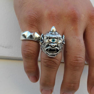 shot of a man wearing the cyclops ring and the big spike ring on his hand