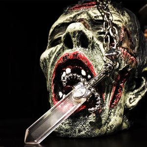 shot of the Dagger Of Light Pendant in silver on a zombie head from the han cholo skulls collection