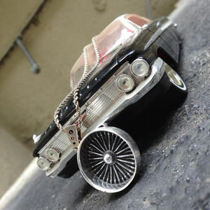 shot of a silver dayton pendant on a classic car toy from the cruising collection
