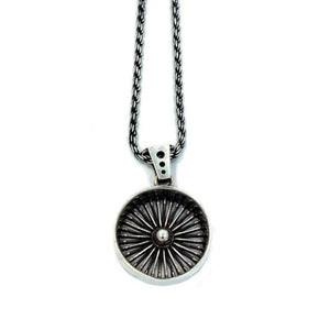 front of the Dayton Pendant in silver from the han cholo cruising collection