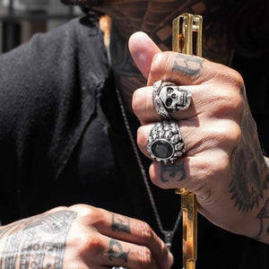 shot of a man with tattoos wearing the cali love ring dead ringer ring in silver
