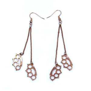 front of the Drop Down Knuckles Earrings in rosegold from the han cholo shadow series