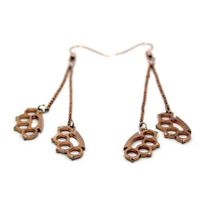up close shot of the Drop Down Knuckles Earrings in rosegold from the han cholo shadow series