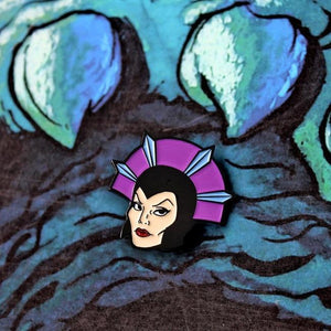 The Evil-Lyn Enamel Pin on a castle grayskull graphic  from the masters of the universe