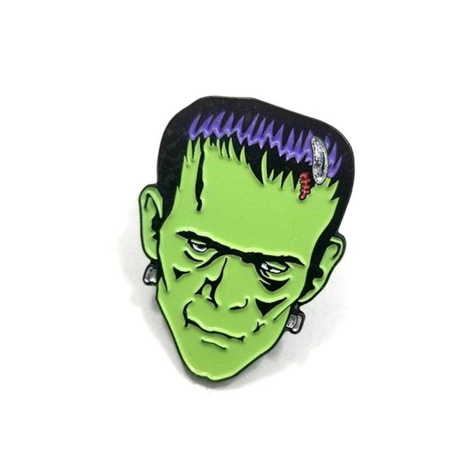 front of the Frankenstein Enamel Pin from the universal monsters jewelry collection