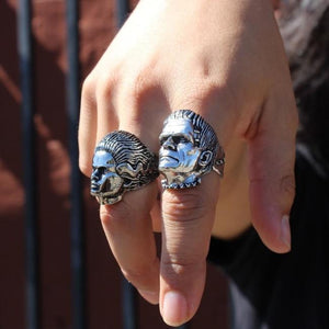 shot of a man wearing both the bride and frankenstein monster rings on their hand in the sunlight
