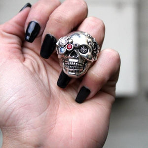 a woman holding up the future human ring from the han cholo fantasy collection
