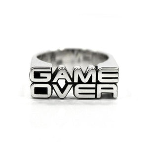 the front view of the game over ring by han cholo on a white background casting a shadow