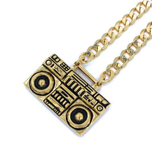 left angle of the Ghetto Blaster Necklace in gold from the han cholo music collection