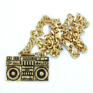 front of the Ghetto Blaster Necklace in gold from the han cholo music collection