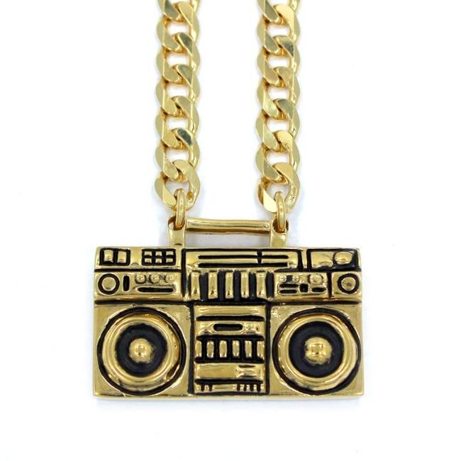 up close view of the Ghetto Blaster Necklace in gold from the han cholo music collection