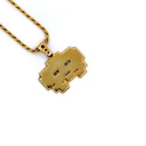 left angle view of the grumpy invader pendant in gold on a white background