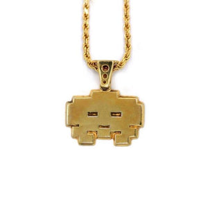 front view of the grumpy invader pendant in gold on a white background