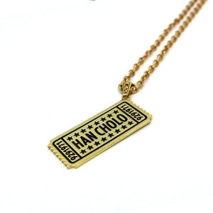 side of the drink ticket pendant in gold from the han cholo jewelry collection