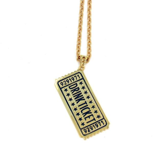 angle of the drink ticket pendant in gold from the han cholo jewelry collection