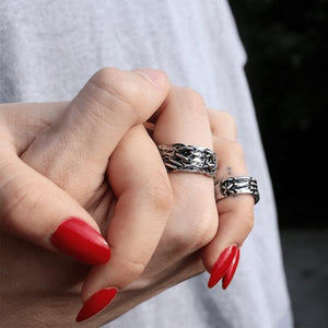 shot of a man and woman holding hands wearing the till death do us part rings