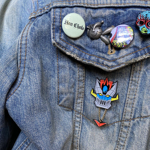 Shogun Warrior inspired Space knight enamel pin on denim jacket with pins