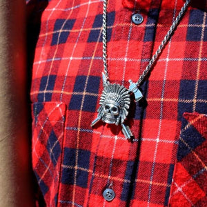 shot of the Indian Chief Necklace in silver from the han cholo skulls collection on a man in red