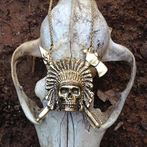 shot of the Indian Chief Necklace in gold from the han cholo skulls collection on a fox skull
