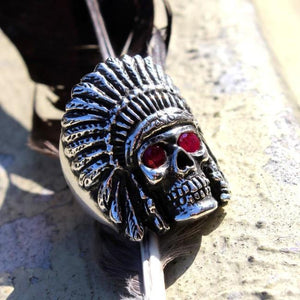 closeup of the Indian Chief Ring in silver with custom ruby eyes from the han cholo skull collection