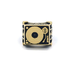 front of the Knights Of The Turntable Ring in gold from the han cholo music collection