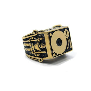 front angle of the Knights Of The Turntable Ring in gold from the han cholo music collection