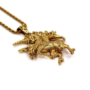 angled left view of the Last Unicorn Pendant in gold from the han cholo fantasy collection