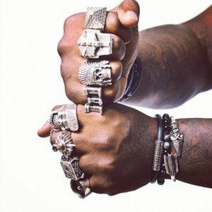 shot of king chip wearing han cholo rings for his album cover photo