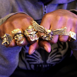 shot of a man wearing all gold han cholo rings