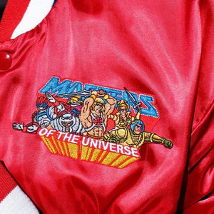 shot of the MOTU Heroes Patch on a red bomber jacket from the masters of the universe collection