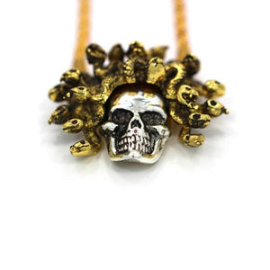 up close detail of the Medusa Skull Pendant in 2 tone from the han cholo fantasy collection