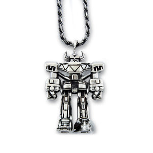 silver megazord pendant from the mighty morphin power rangers laying flat on a white background