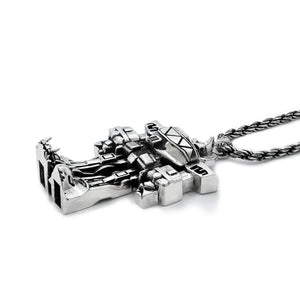3/4 view of the megazord pendant from the mighty morphin power rangers on a white background