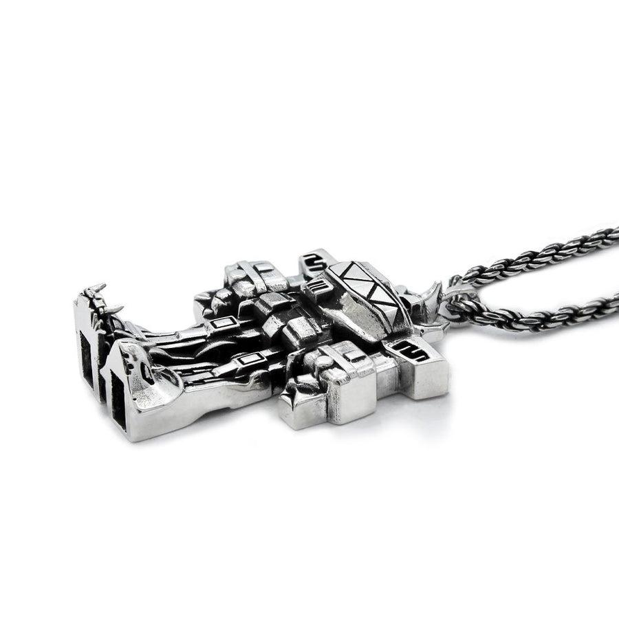 front view of the megazord pendant from the mighty morphin power rangers on a white background