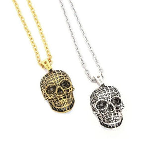 shot of the Mesh Skull Pendants in gold and silver from the han cholo skulls collection