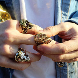 shot of a man wearing the Mesh Skull Ring in gold from the han cholo skulls collection