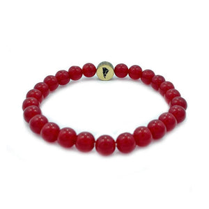 red agate power ranger bead bracelet made of red agate on a white surface showing back of the coin
