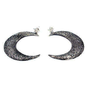up close shot of the Moon Earrings in silver from the han cholo fantasy collection