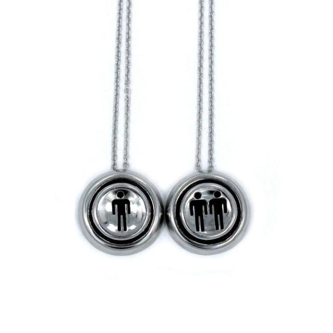 up close view of the Player 1 player 2 necklaces on a white background