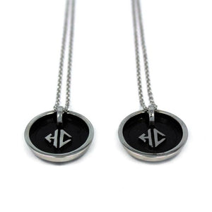 back side view of the Player 1 player 2 necklaces on a white background