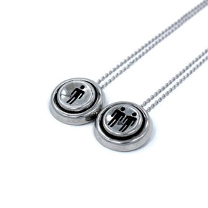 right side view of the Player 1 player 2 necklaces on a white background