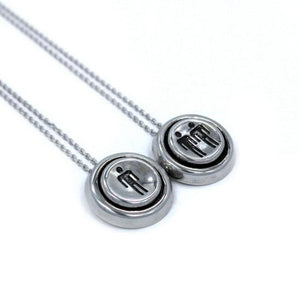 left side view of the Player 1 player 2 necklaces on a white background