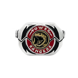 shot of the mighty morphin power rangers red t.rex morpher coin on a white background