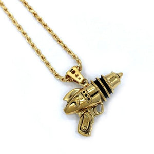 left angled shot of the Ray Gun Pendant in gold on a white surface