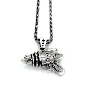 right side shot of the Ray Gun Pendant in silver on a white surface