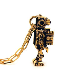 left side profile view of the Robot Pendant in gold on a white background