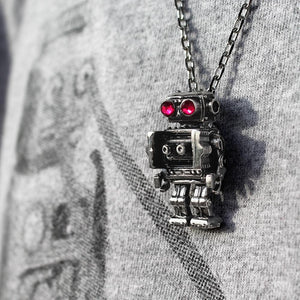 shot of the robot pendant hanging on a person in a grey robot shirt