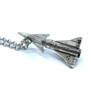 side shot of the rocket blast pendant in silver from the han cholo alien collection